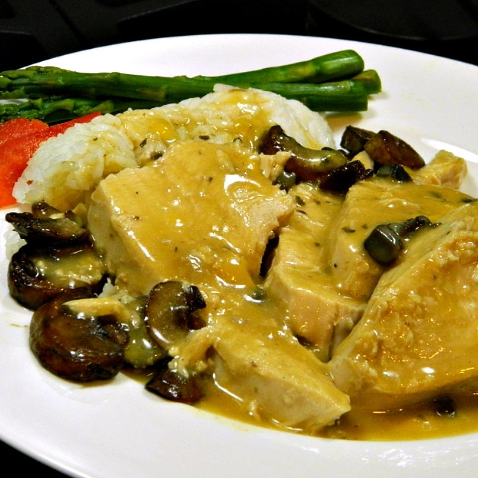 Slow Cooker Turkey Breast With Gravy on a white plate