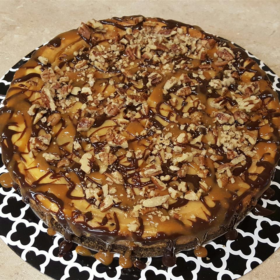 Turtles® Cheesecake on black and white plate