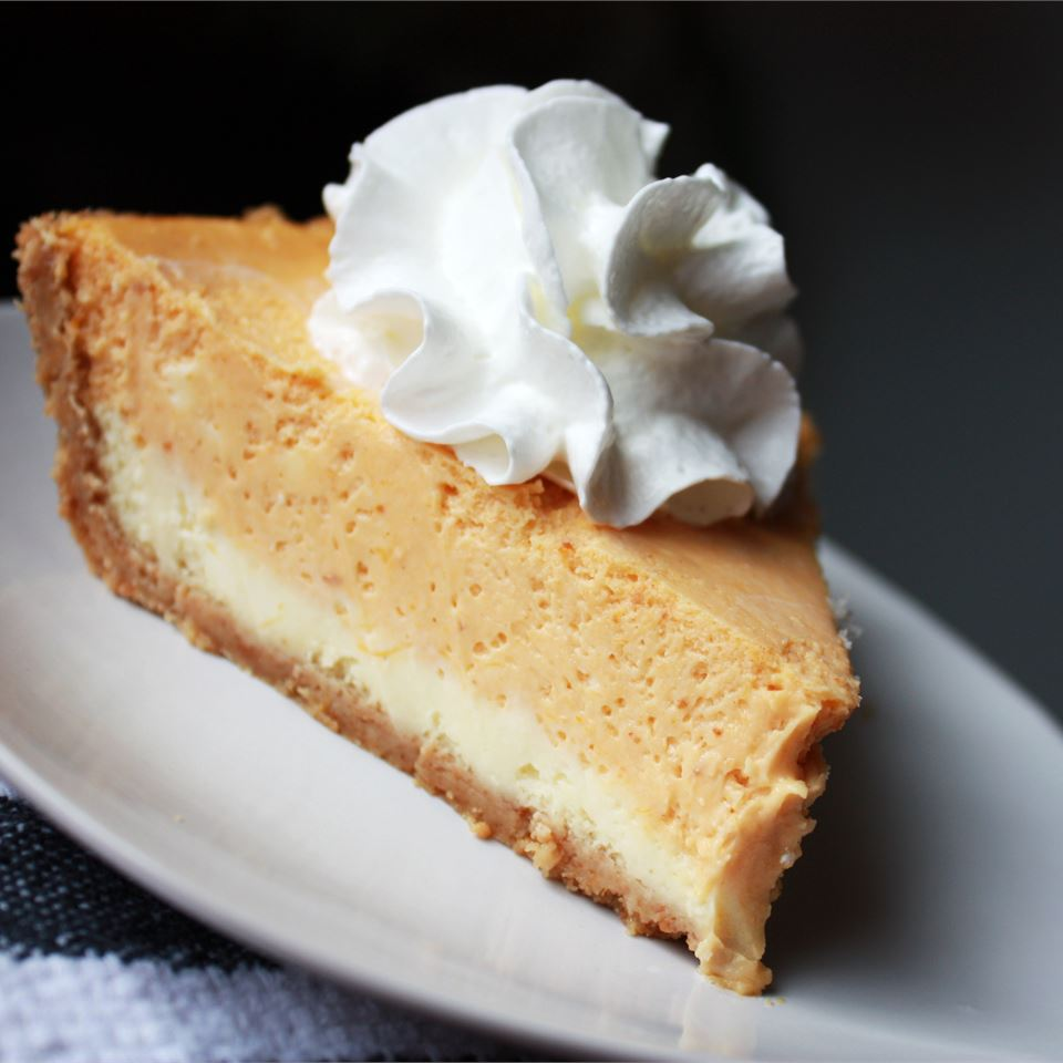 Double Layer Pumpkin Cheesecake on a white plate