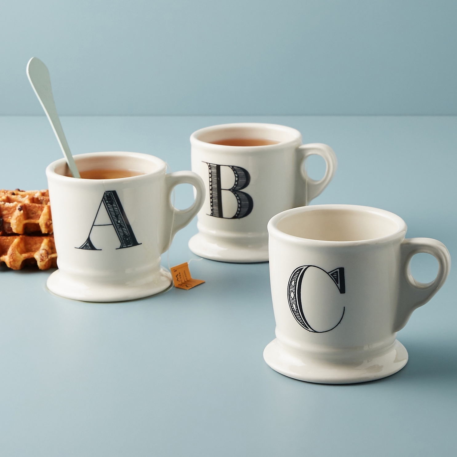 three mugs with initials on them