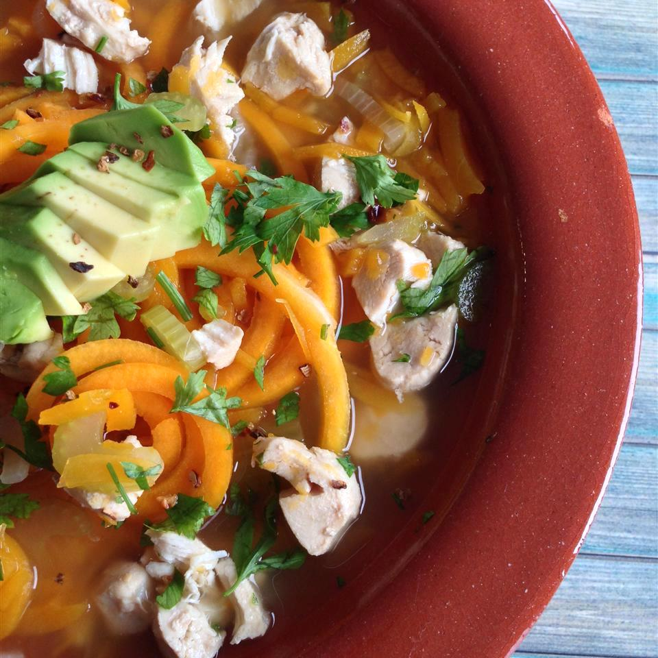 Butternut Squash Noodle Soup with Turkey in red bowl