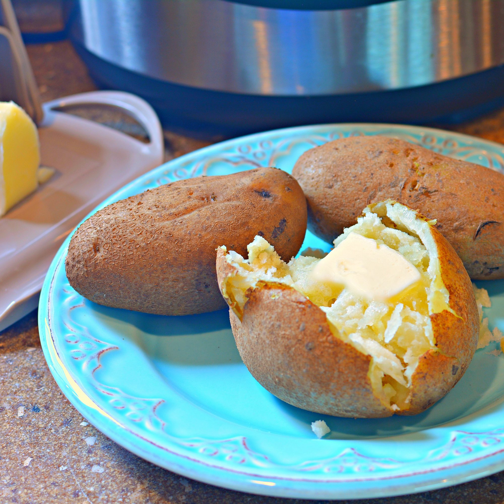 three whole russet potatoes cooked in the pressure cooker