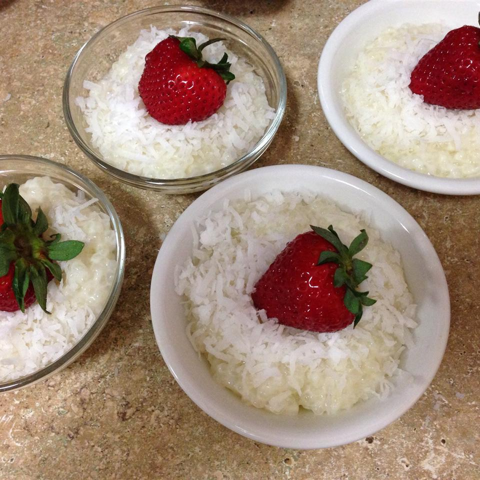 Four bowls of Coconut Tapioca Pudding topped with strawberries