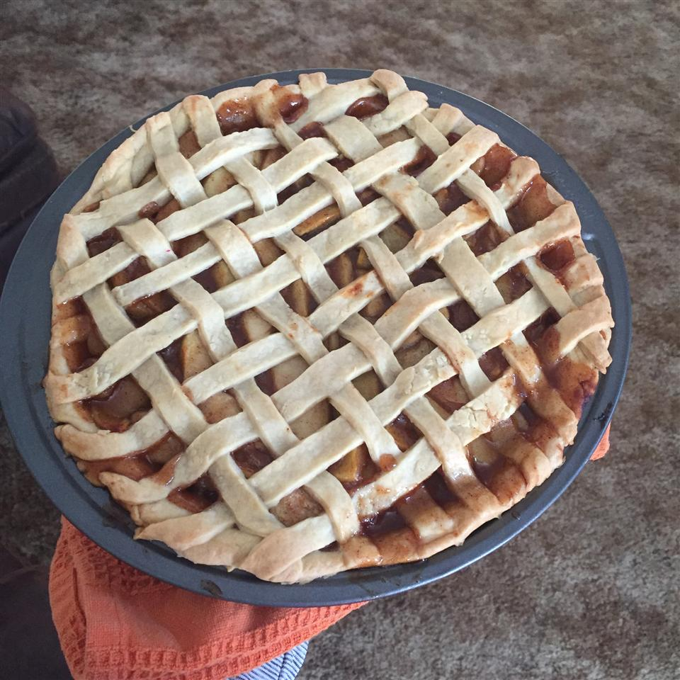 No Sugar Apple Pie with a lattice crust on a red towel