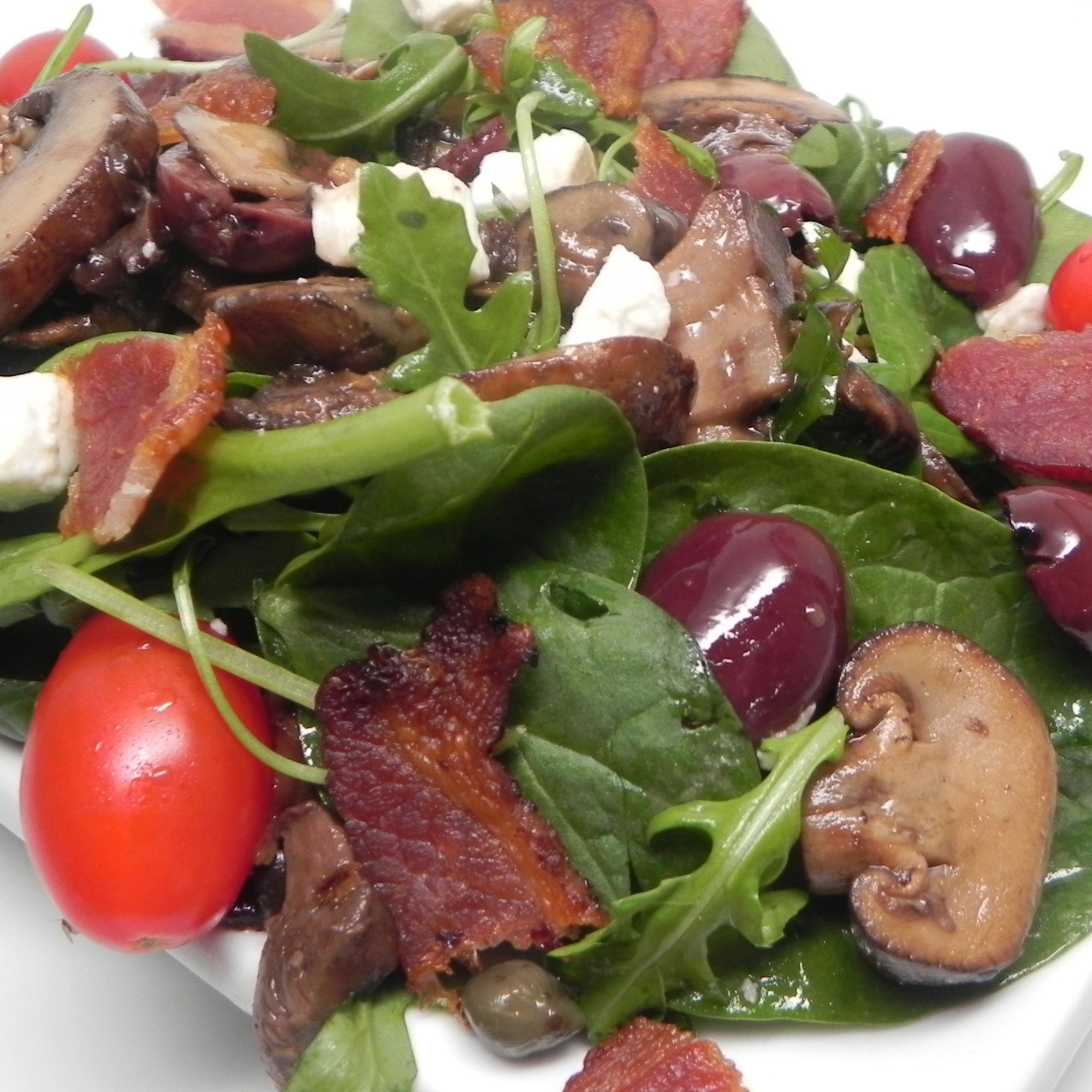 Warm Mushroom Salad with Pancetta on a white plate