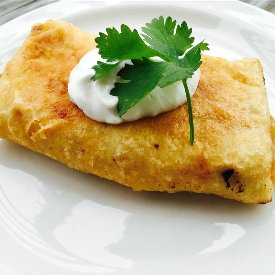 Chicken Chimichangas with Sour Cream Sauce on a white plate