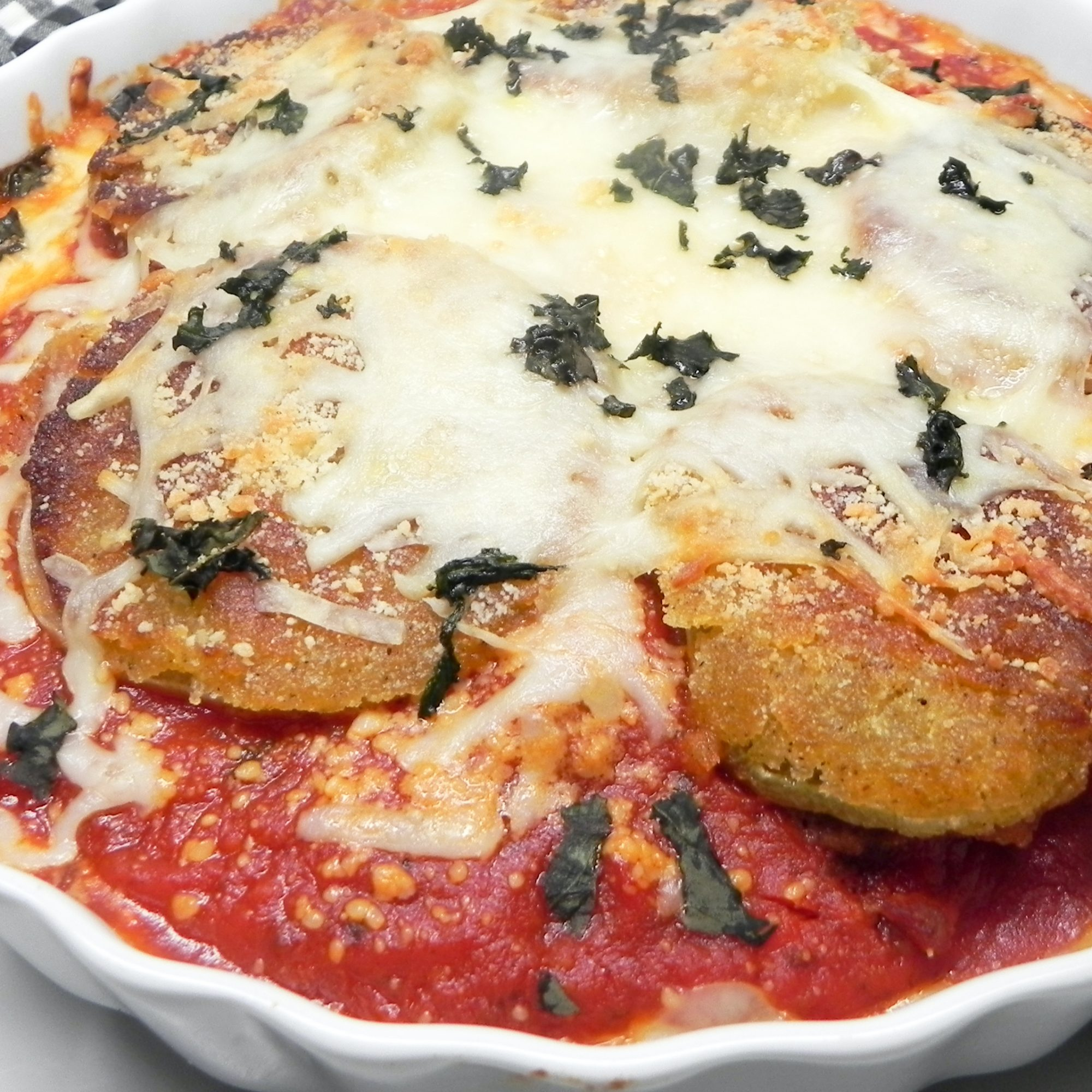 Fried Green Tomato Parmesan in a white dish