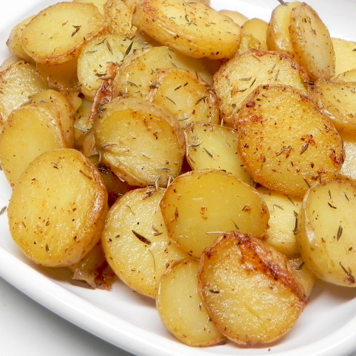 roasted potatoes on white dinnerware