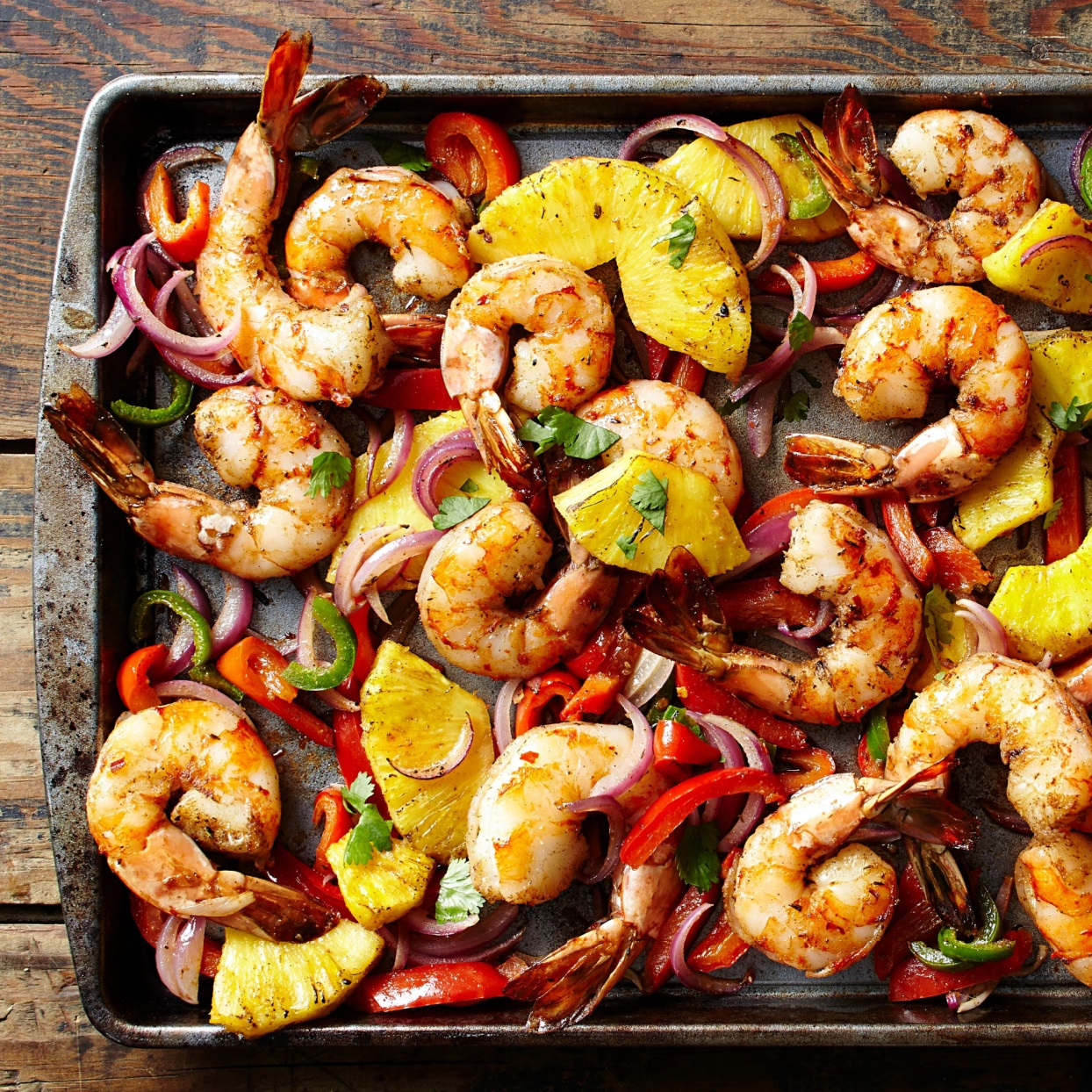 shrimp, pineapple, onion, and peppers roasted on a sheet pan