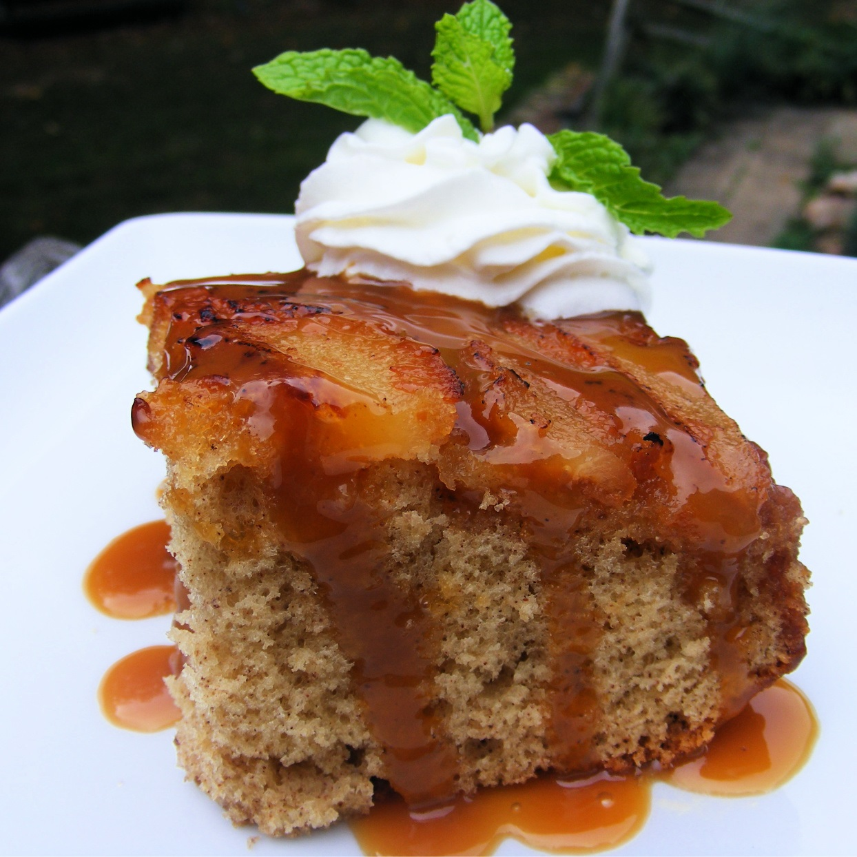 spice cake with sliced pears, whipped cream, and caramel drizzle
