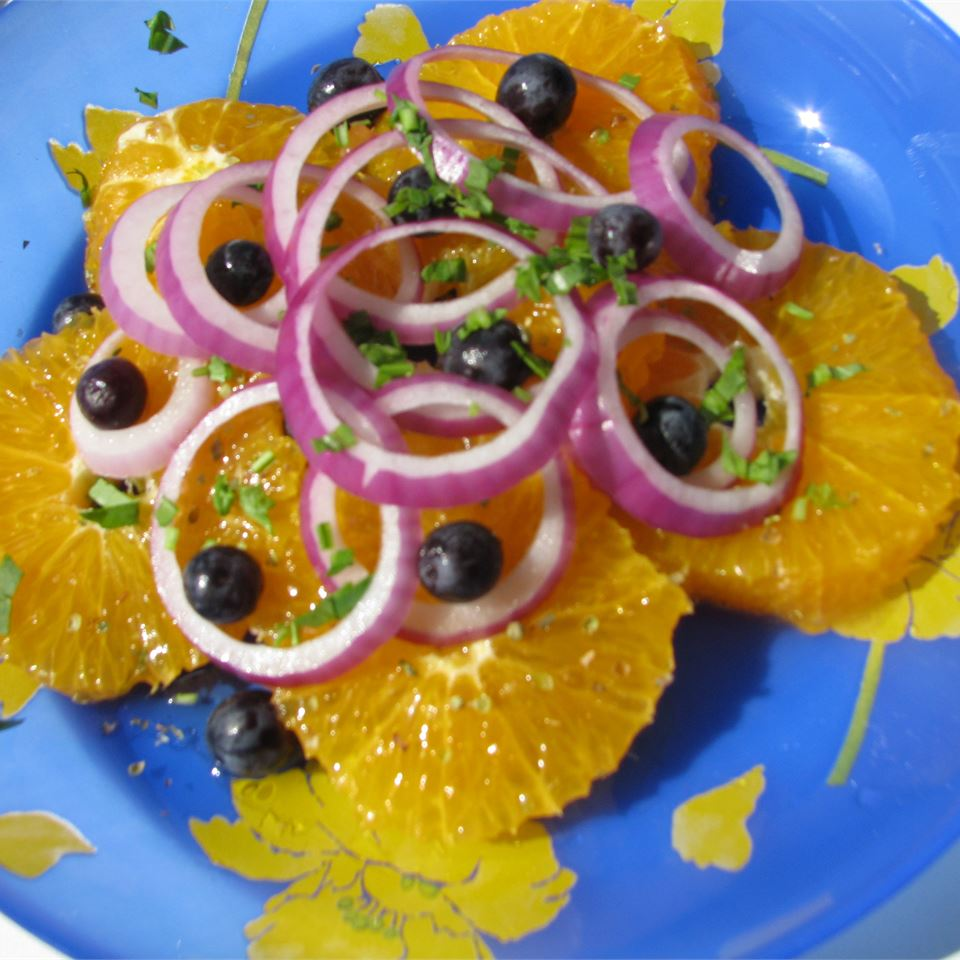 Orange and Onion Salad on a blue and yellow background