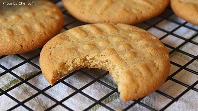 72040.jpg chef john's peanut butter cookies with a bite missing