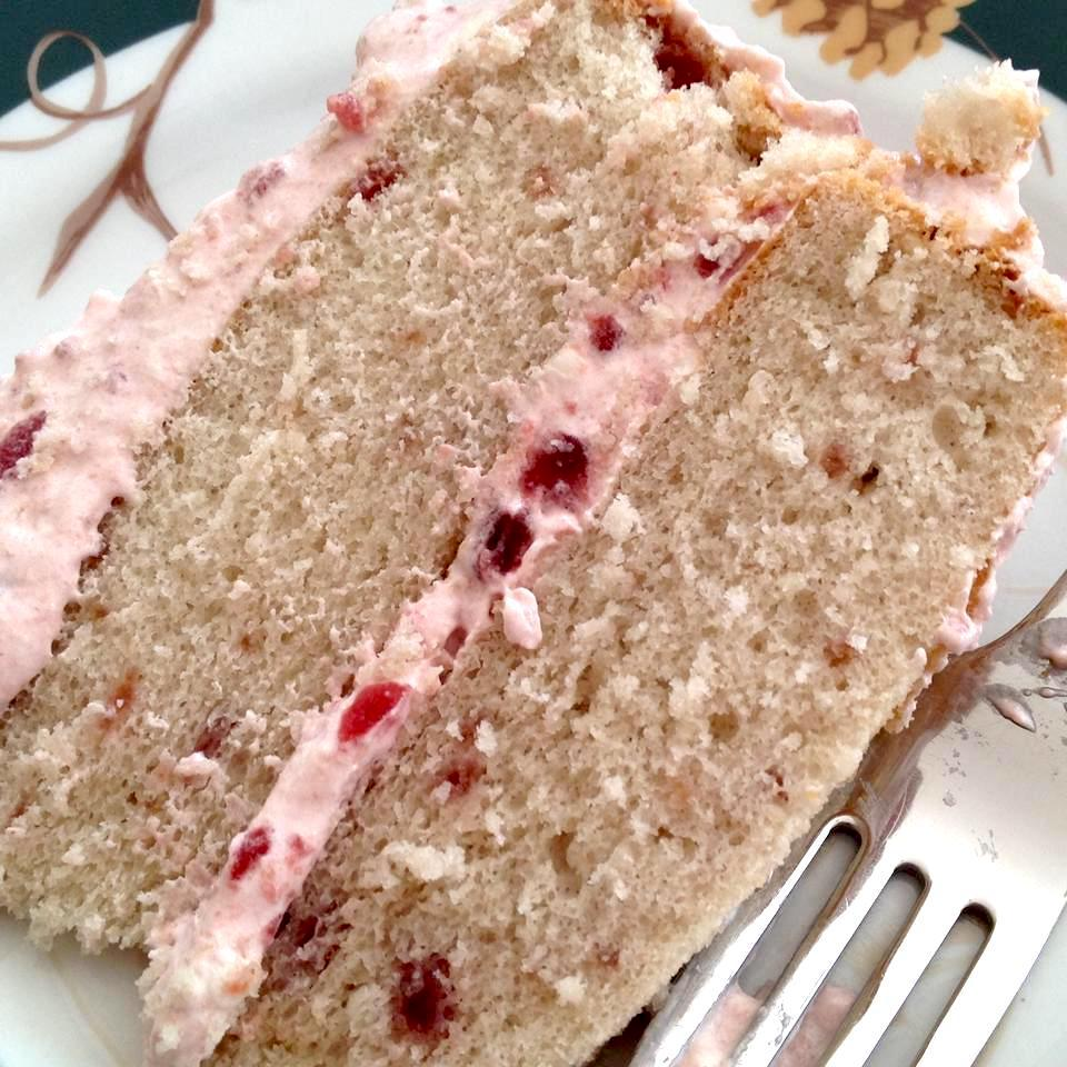 Cranberry Cake slice on a white plate