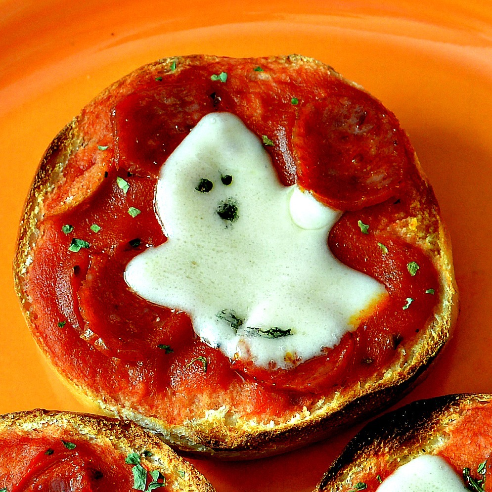 Easy Mini Bagel Pizzas with a pepperoni and cheese ghost design