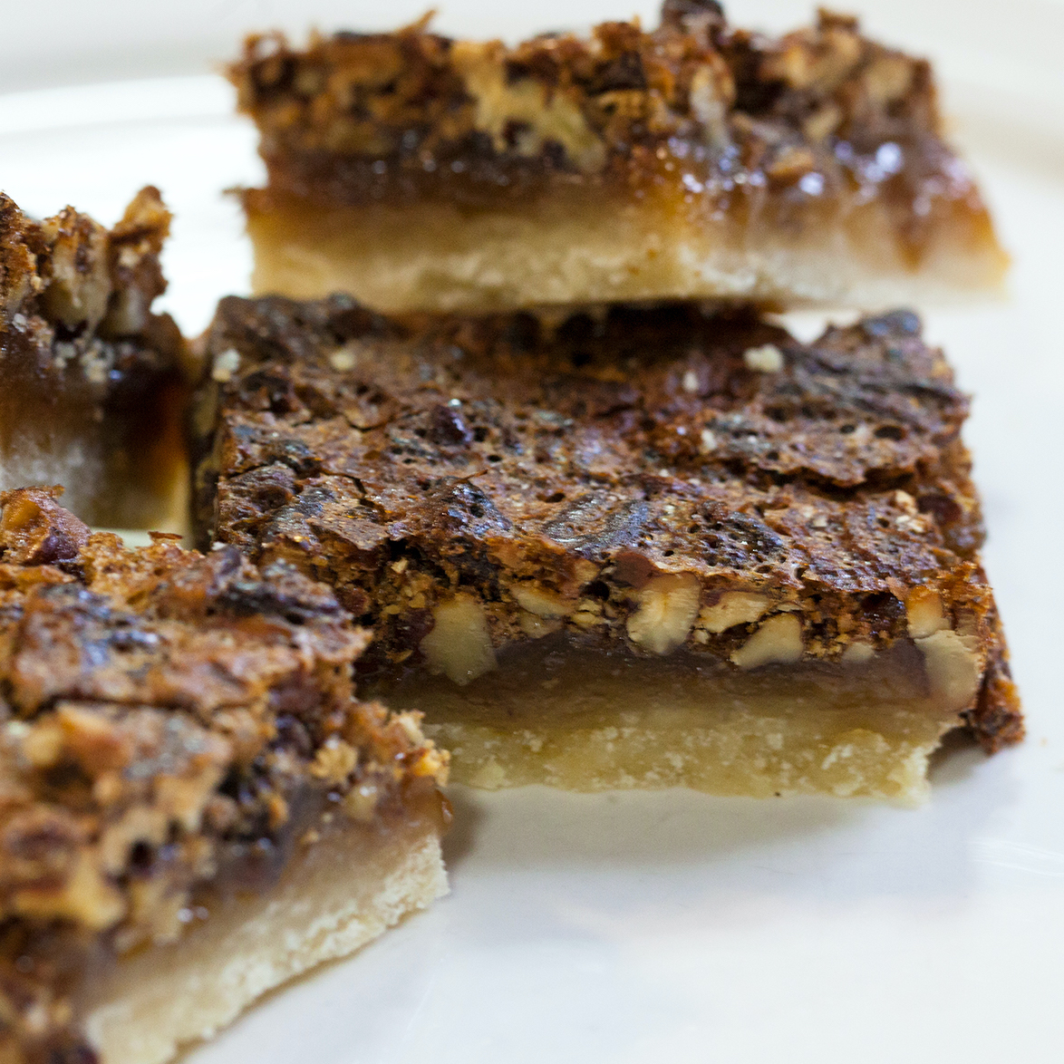 Pecan Pie Bars I on a white plate