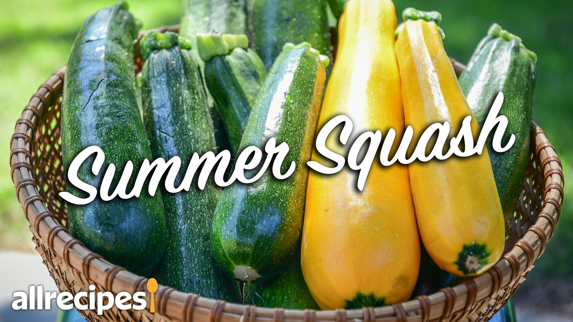 green and yellow zucchini summer squash in a basket