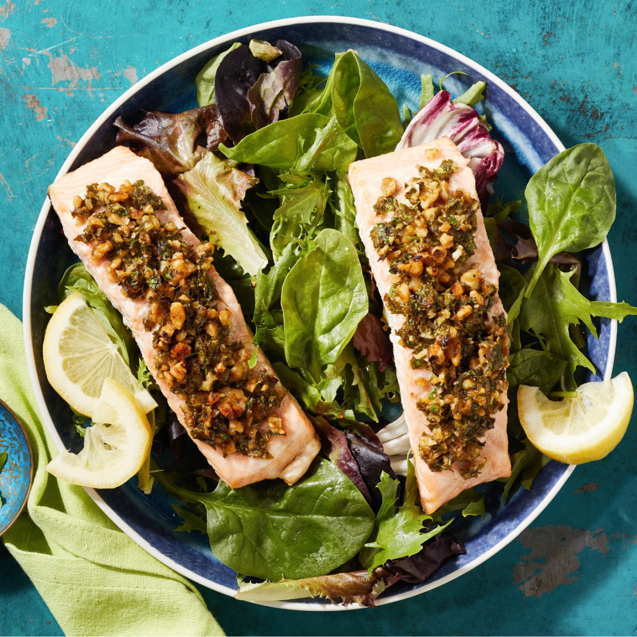 salmon crusted with parsley and walnuts on a bed of lettuce