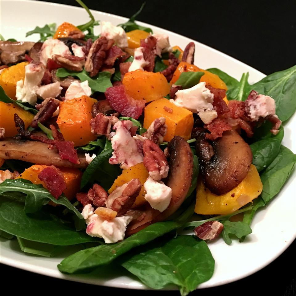 Arugula Salad with Bacon and Butternut Squash on a white plate