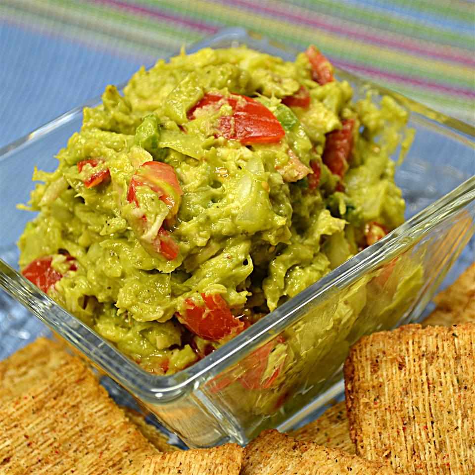 Tuna and Avocado Salad in a clear bowl with crackers