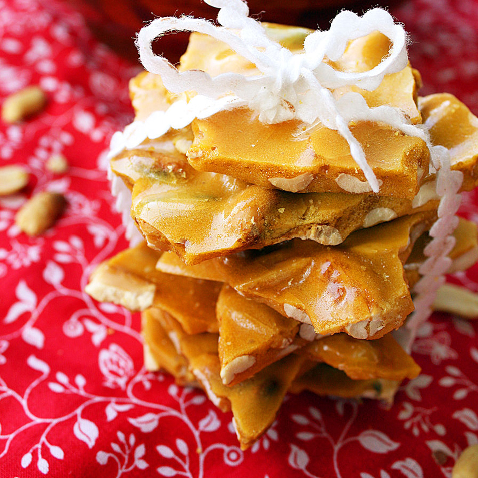 Mom's Best Peanut Brittle tied together with ribbon