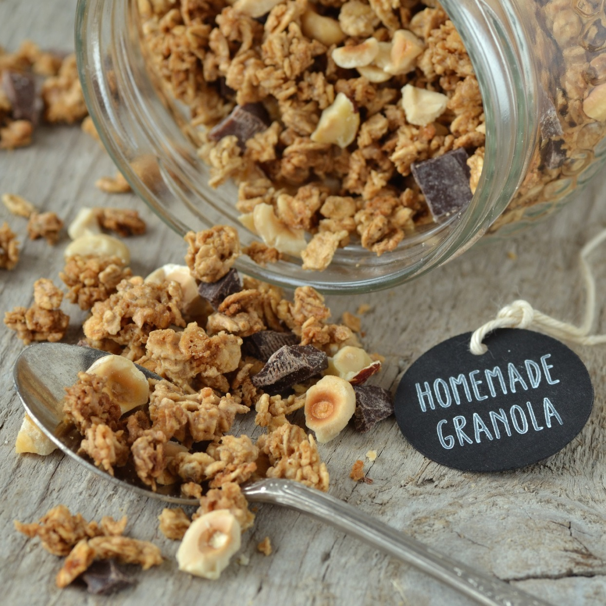 homemade granola spilling out of a jar