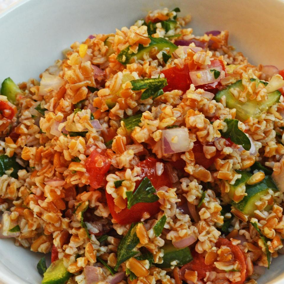 tabbouleh salad with bulgur, green onions, parsley, mint, tomatoes, and cucumber