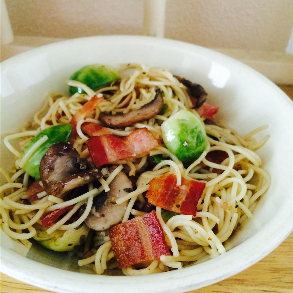 Bacon, Brussels Sprouts, and Mushroom Linguine in a white bowl