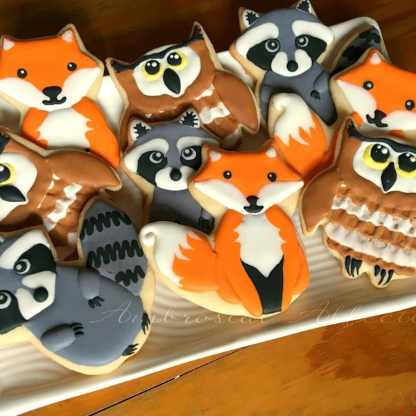 sugar cookies shaped like raccoons, owls, and foxes