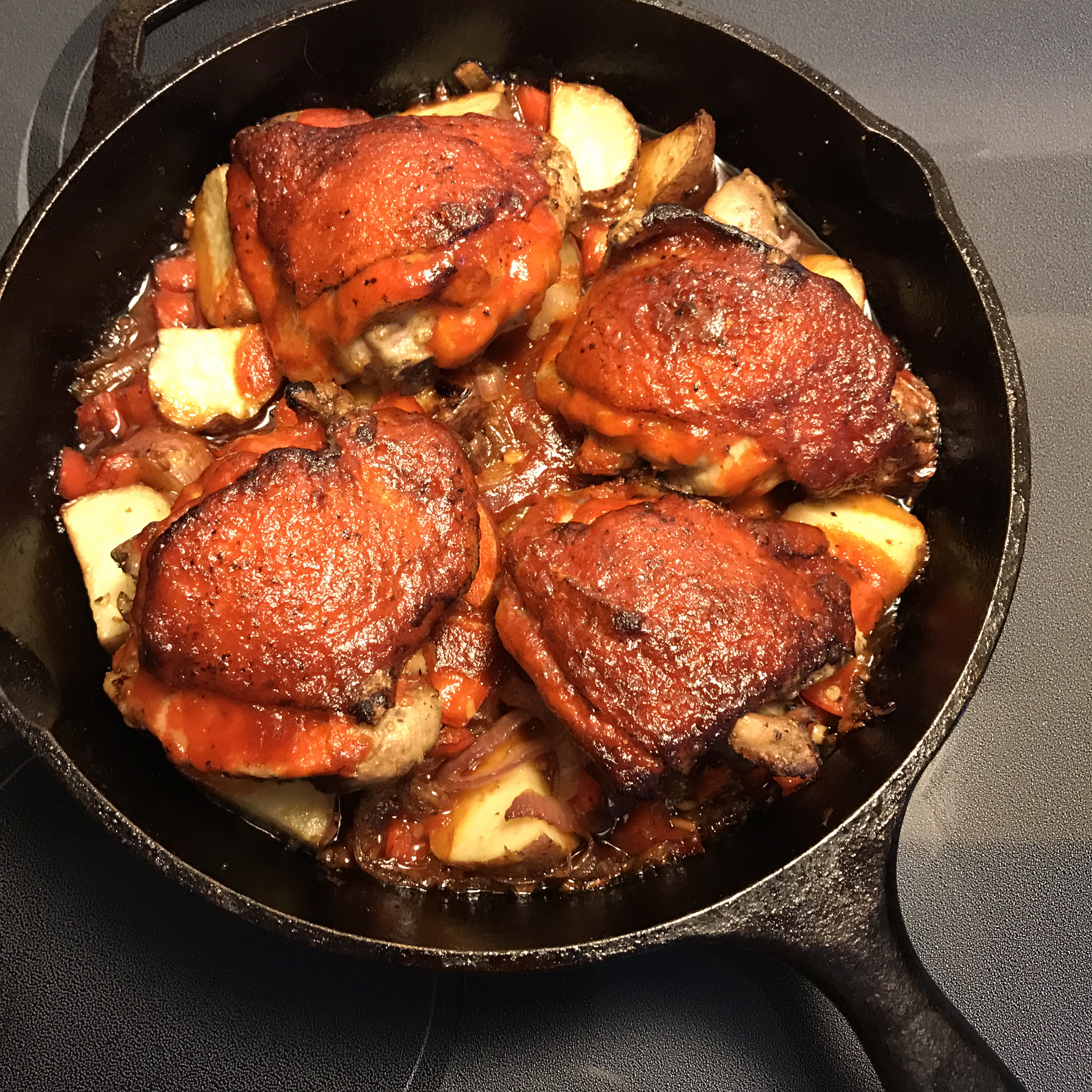 One-Pan Sriracha Chicken and Veggies in a cast iron skillet