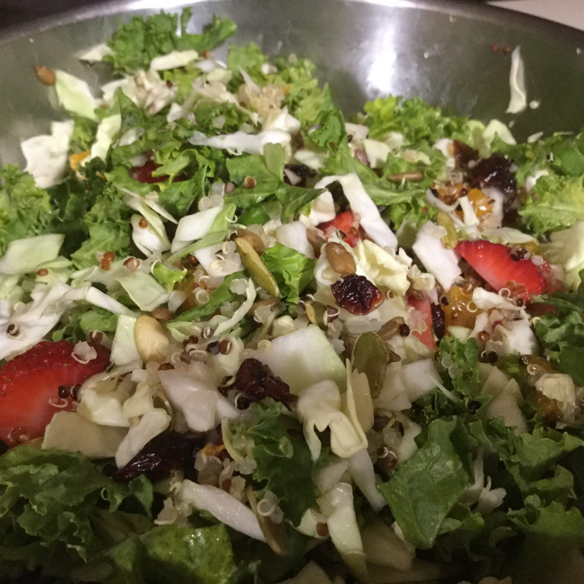 Kale, Cabbage, and Brussels Sprout Salad in a mixing bowl