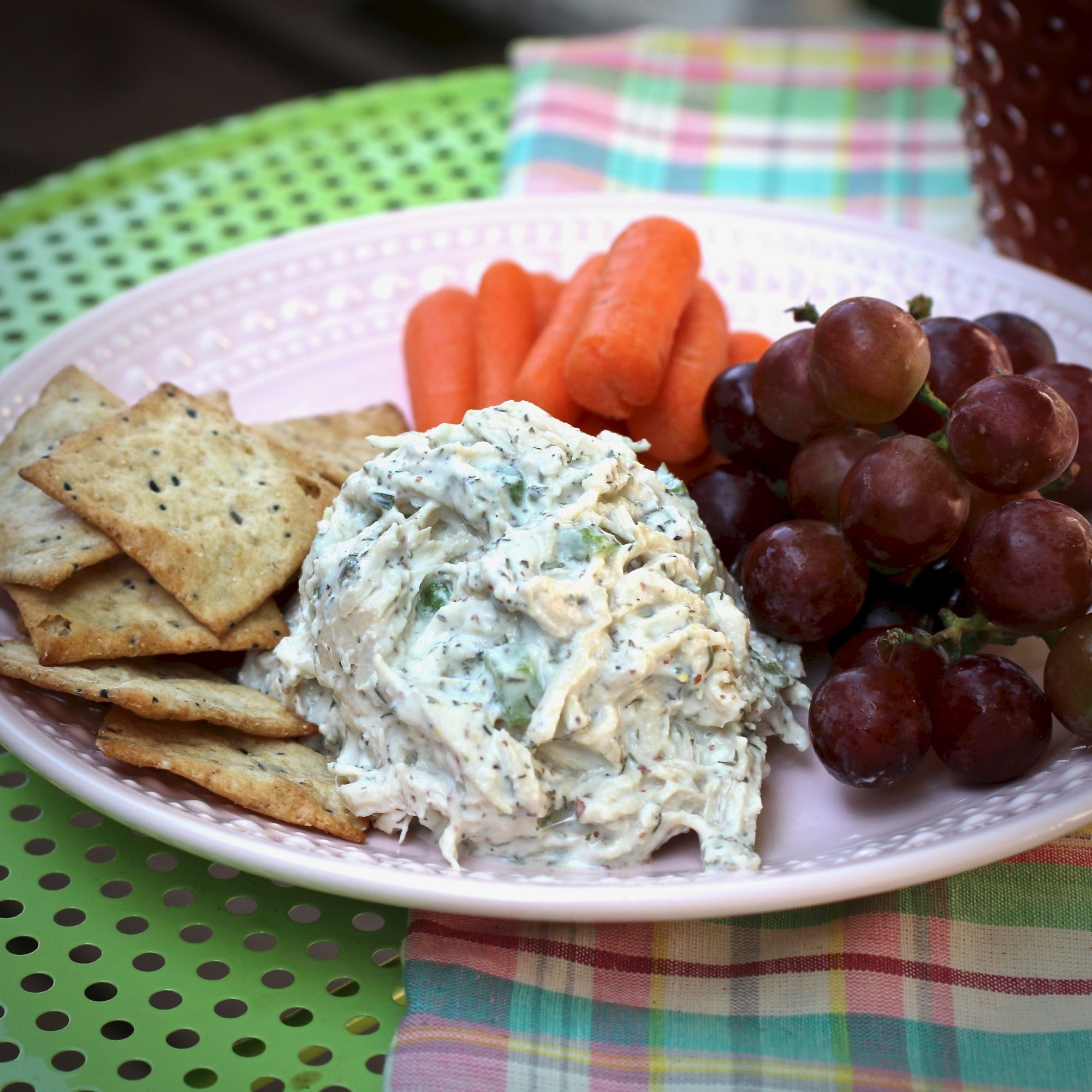 Greek Yogurt Chicken Salad served with crackers, grapes, and carrots