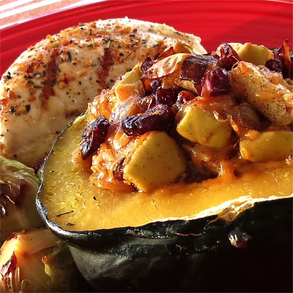 Apple-Stuffed Acorn Squash on a red plate