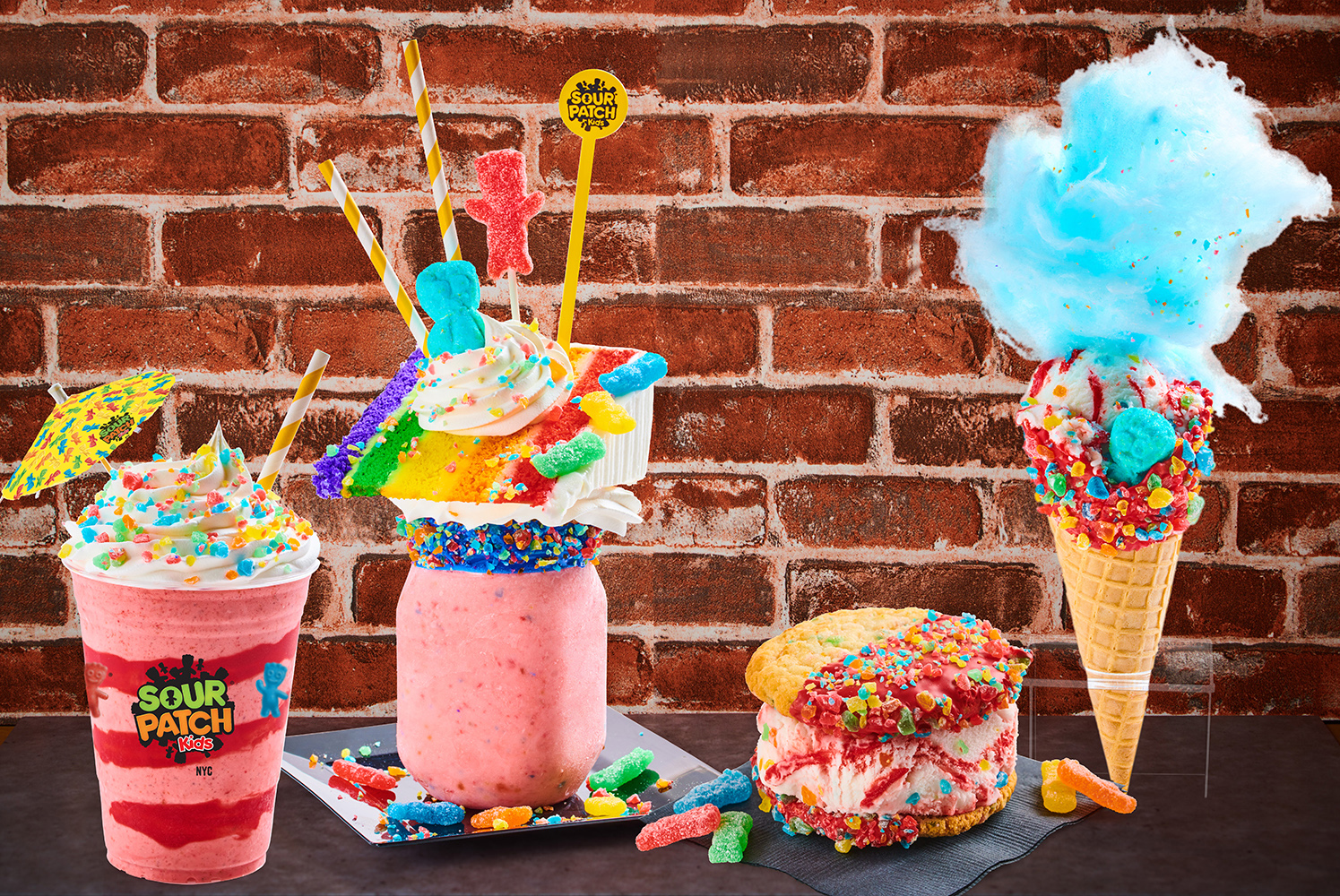 a variety of sweets including a milkshake and ice cream sandwich made with sour patch kids