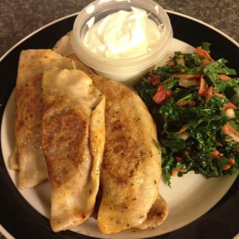 Beet Pierogies on a plate with greens