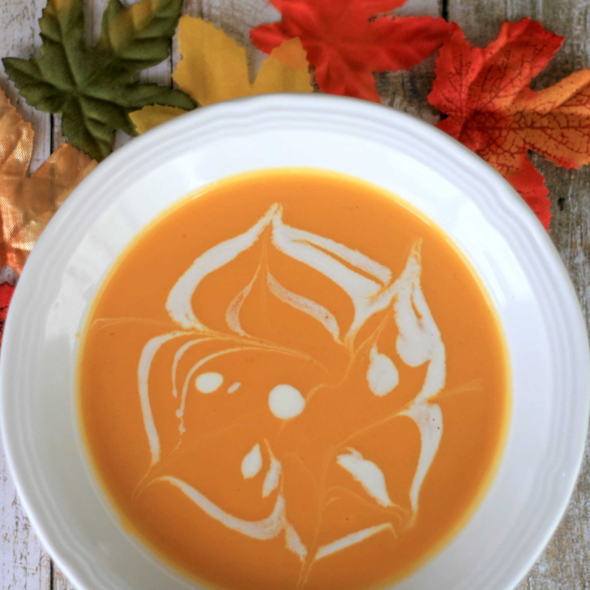 Instant Pot® Butternut Squash and Pear Soup in a white bowl