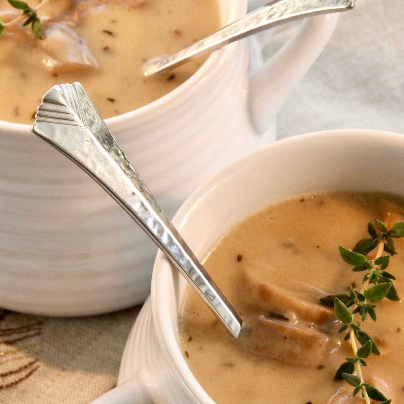 Two bowls of Instant Pot Creamy Mushroom Soup