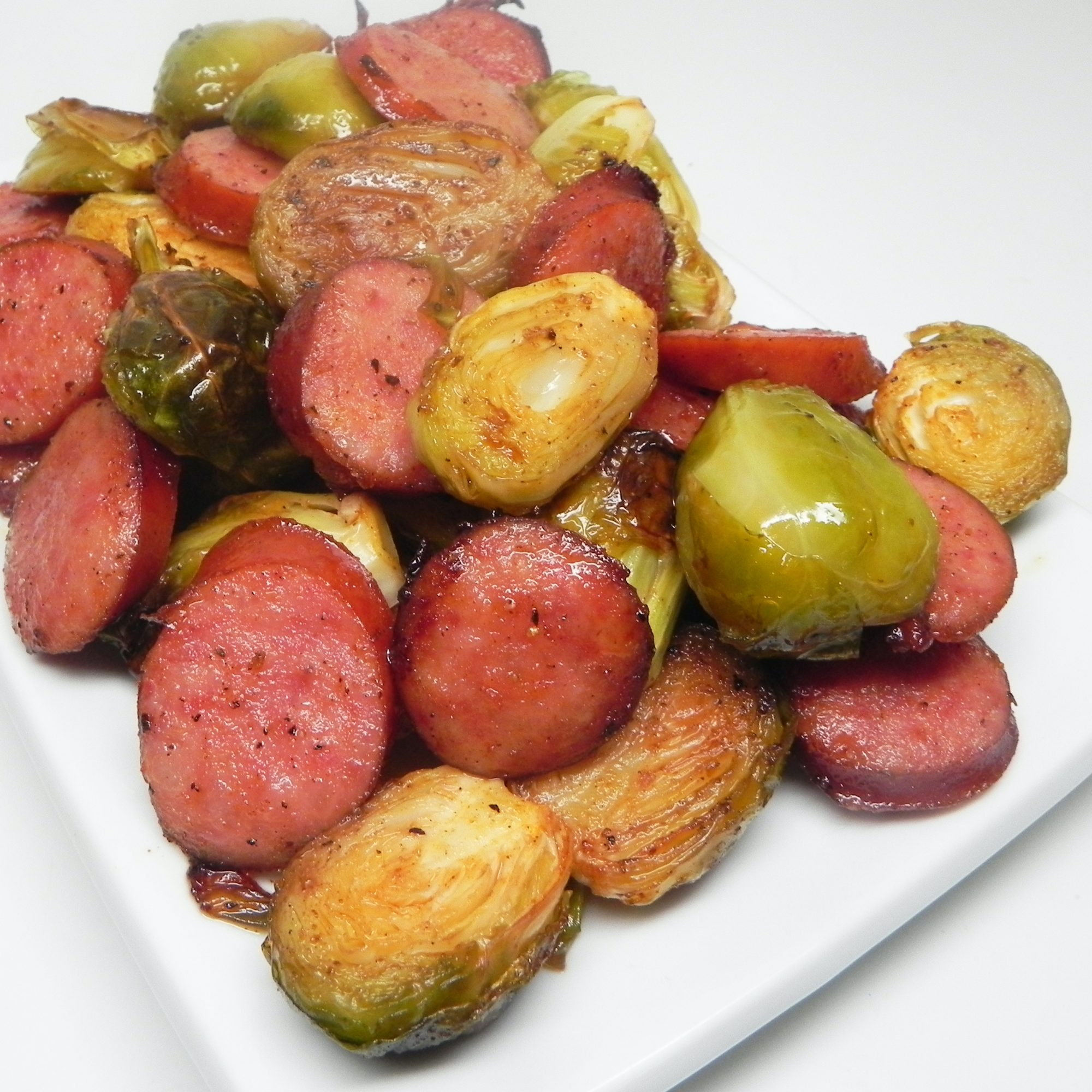 Roasted Brussels Sprouts and Kielbasa on a white dish