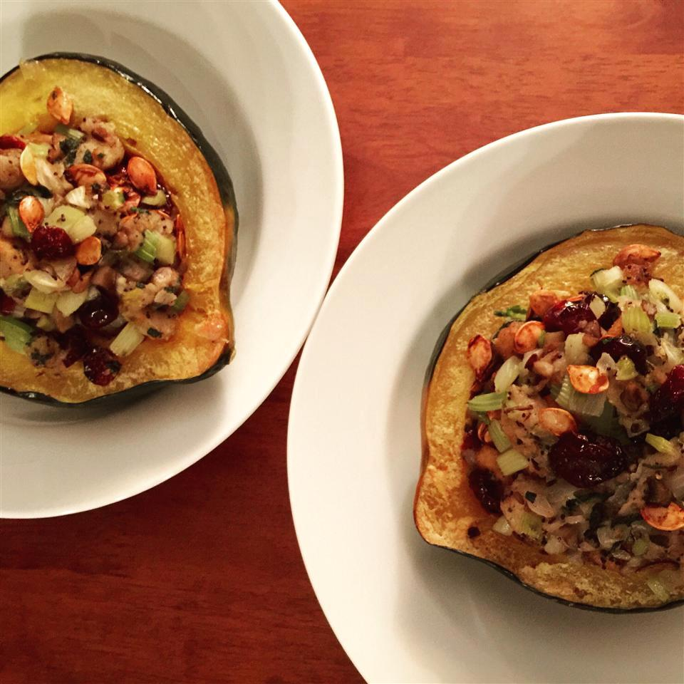 Two servings of Wild Rice Stuffed Acorn Squash on white plates