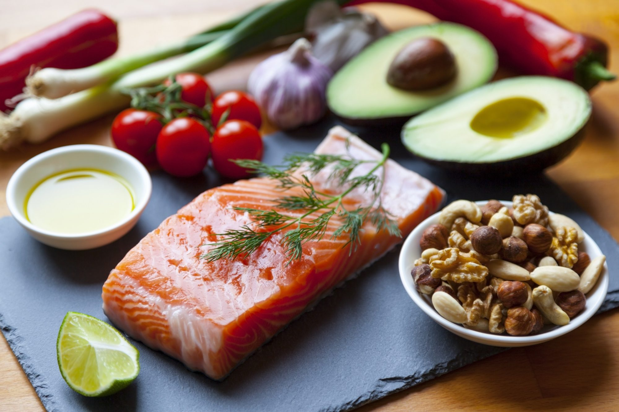 foods for the mediterranean diet salmon nuts citrus tomatoes avocado garlic green onion peppers