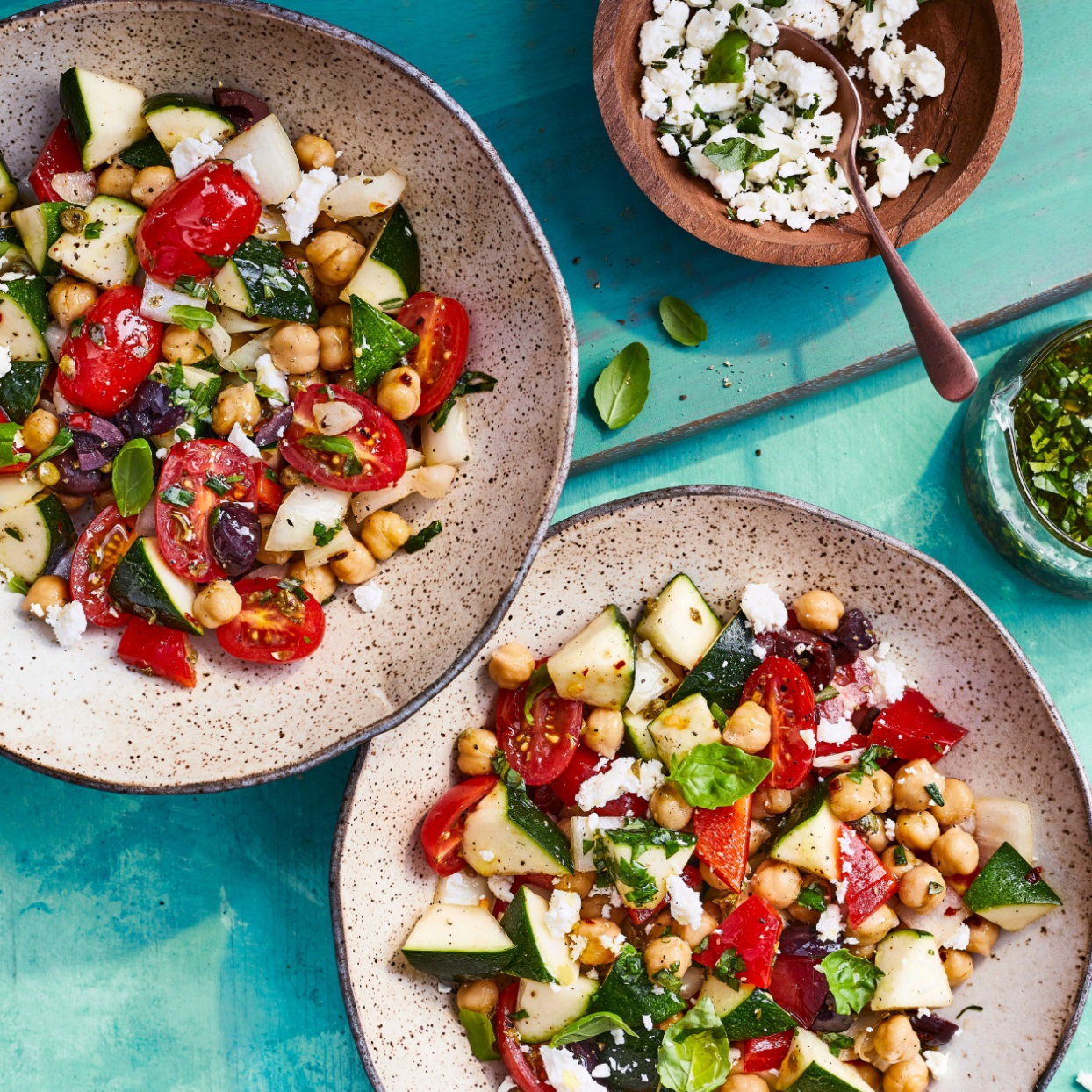 zucchini and chickpea salad on plates