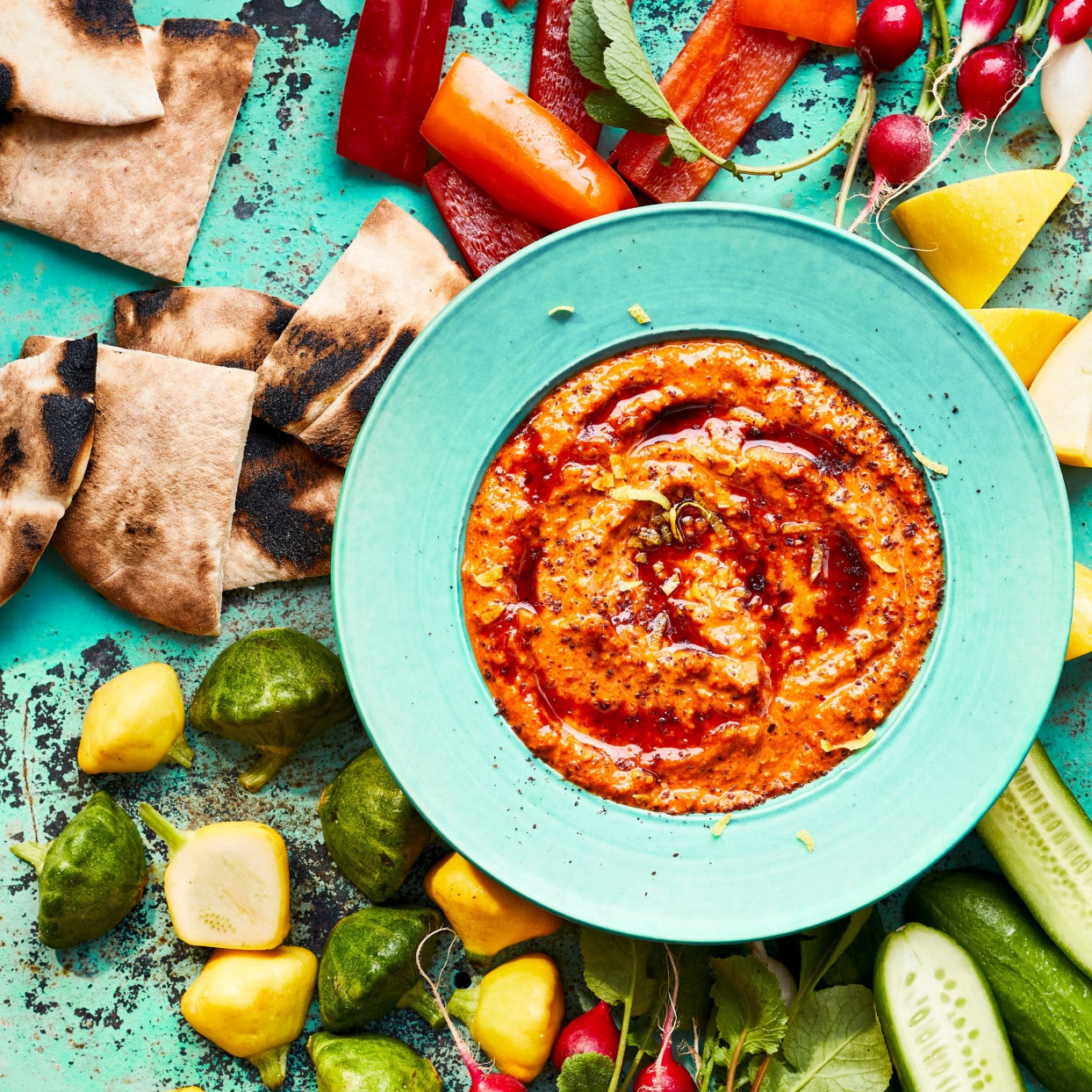 red pepper and walnut dip with vegetables and pita bread