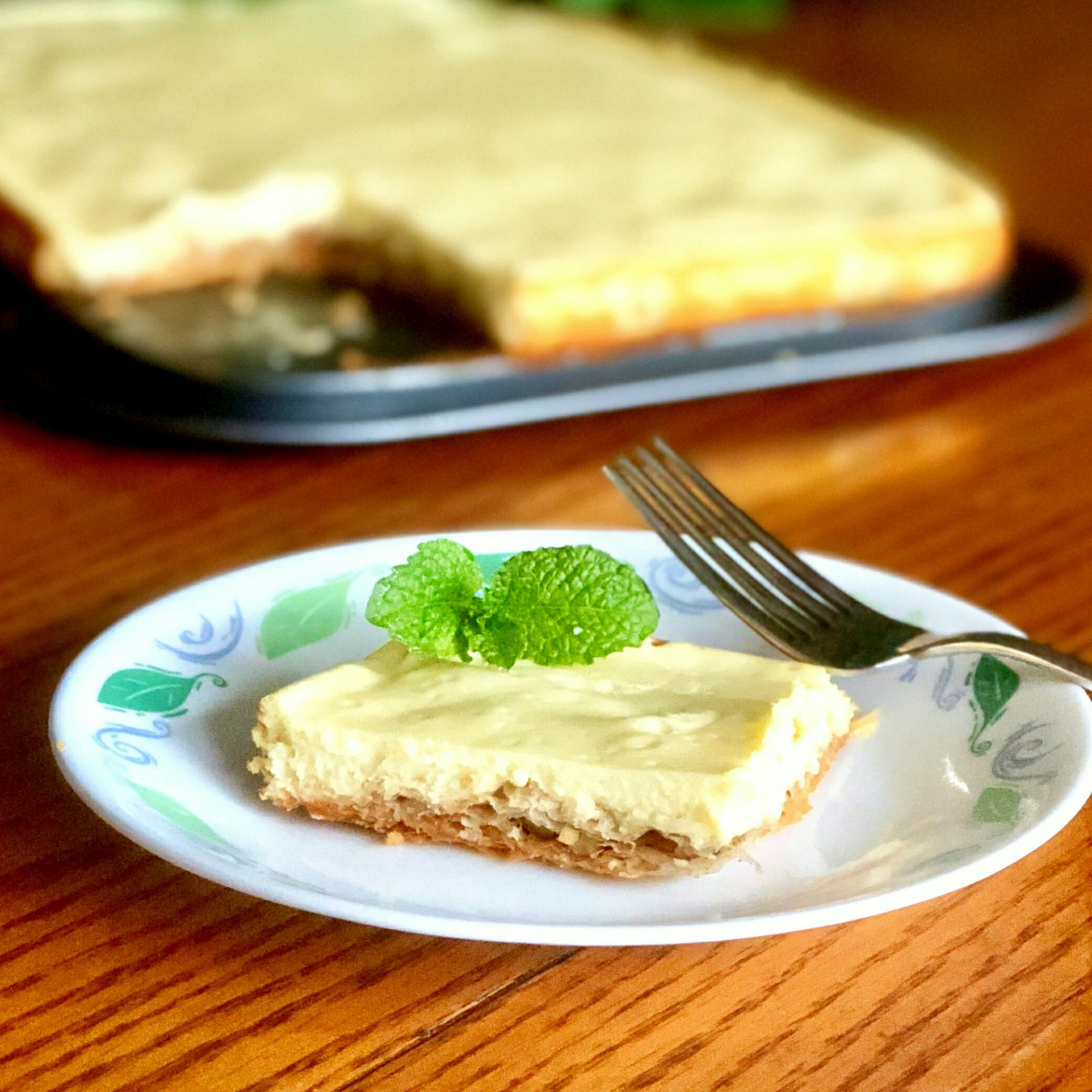 Baklava Cheesecake on a small plate with a wooden background