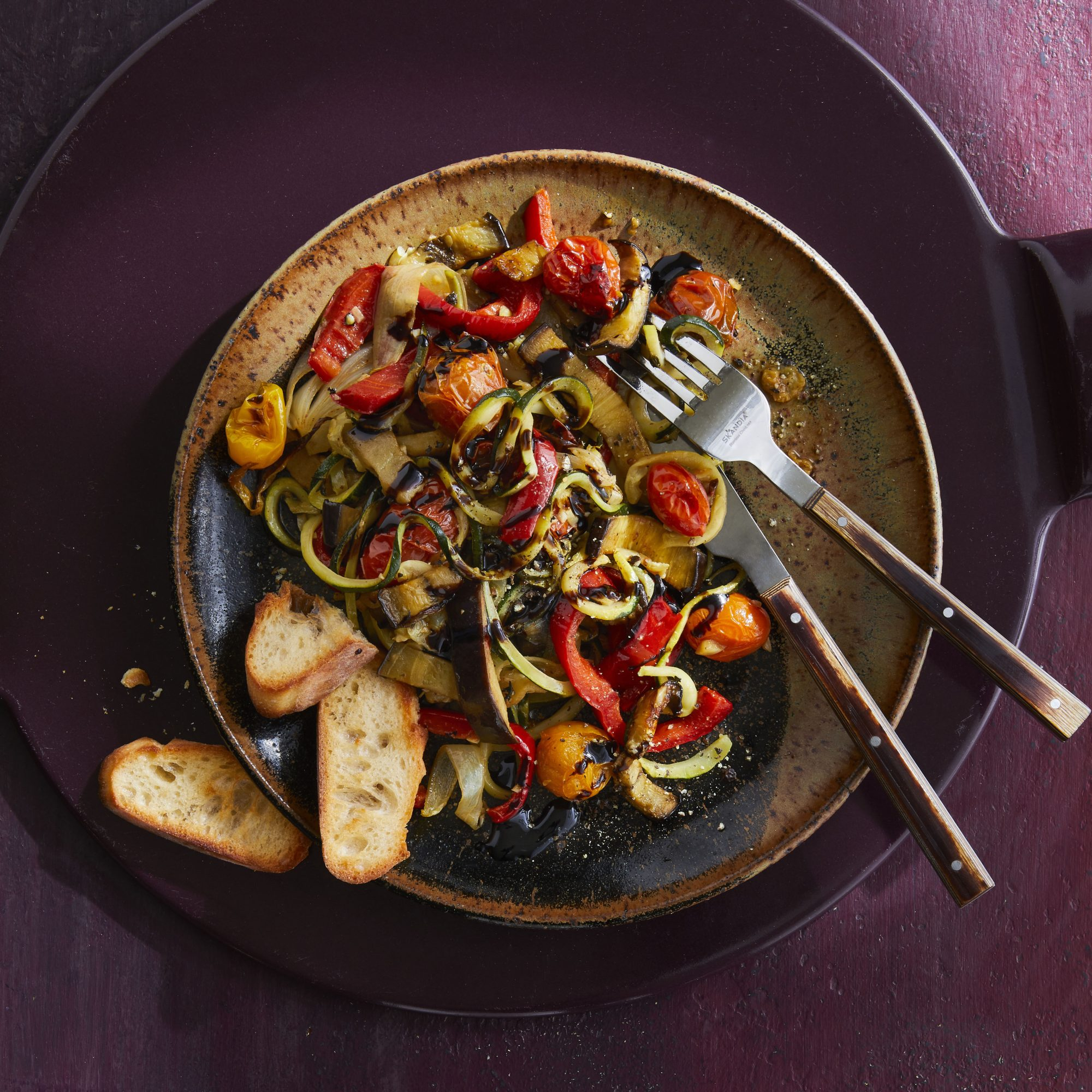plate of ratatouille with a side of toasted bread