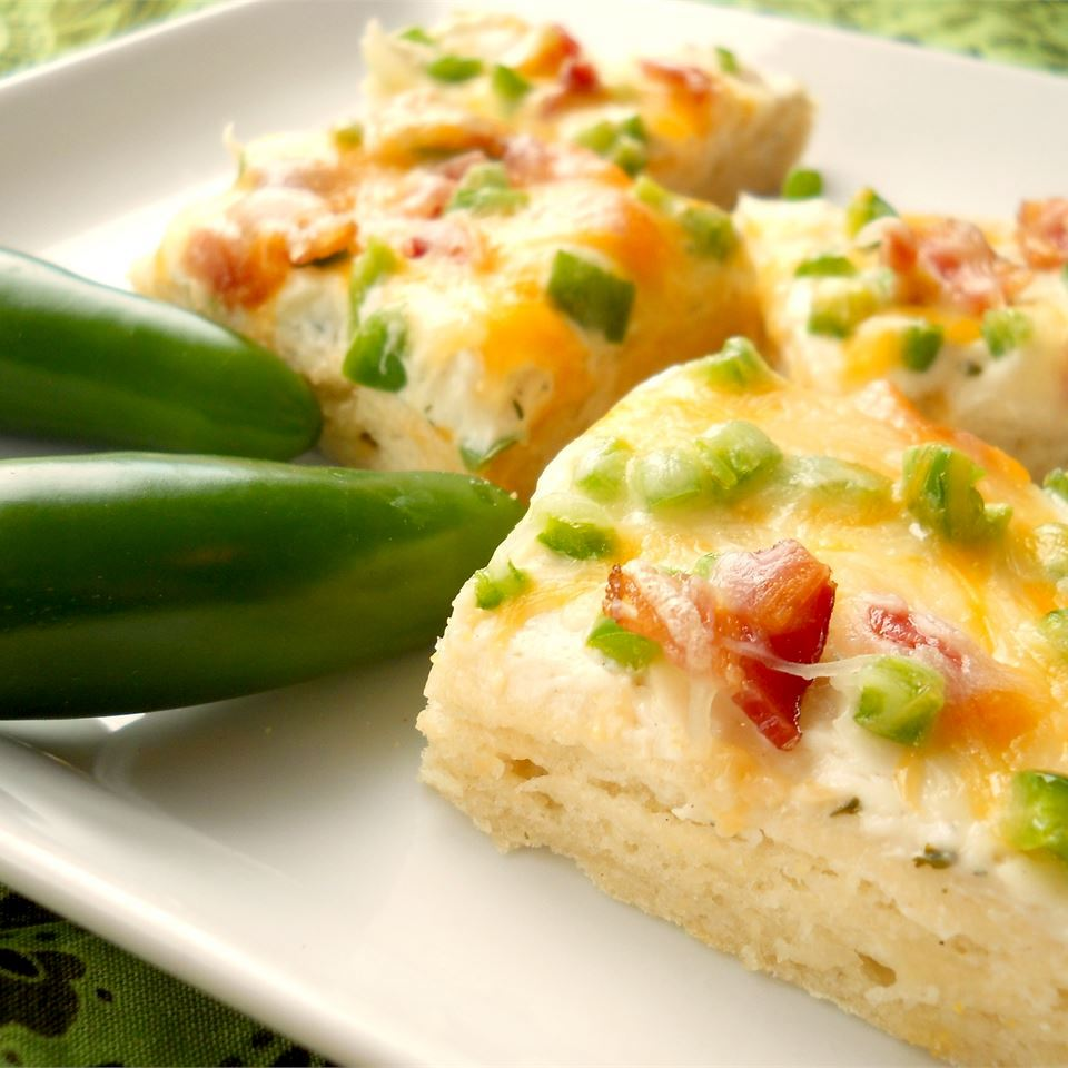 Jalapeno Popper Pizza on a white dish with jalapenos