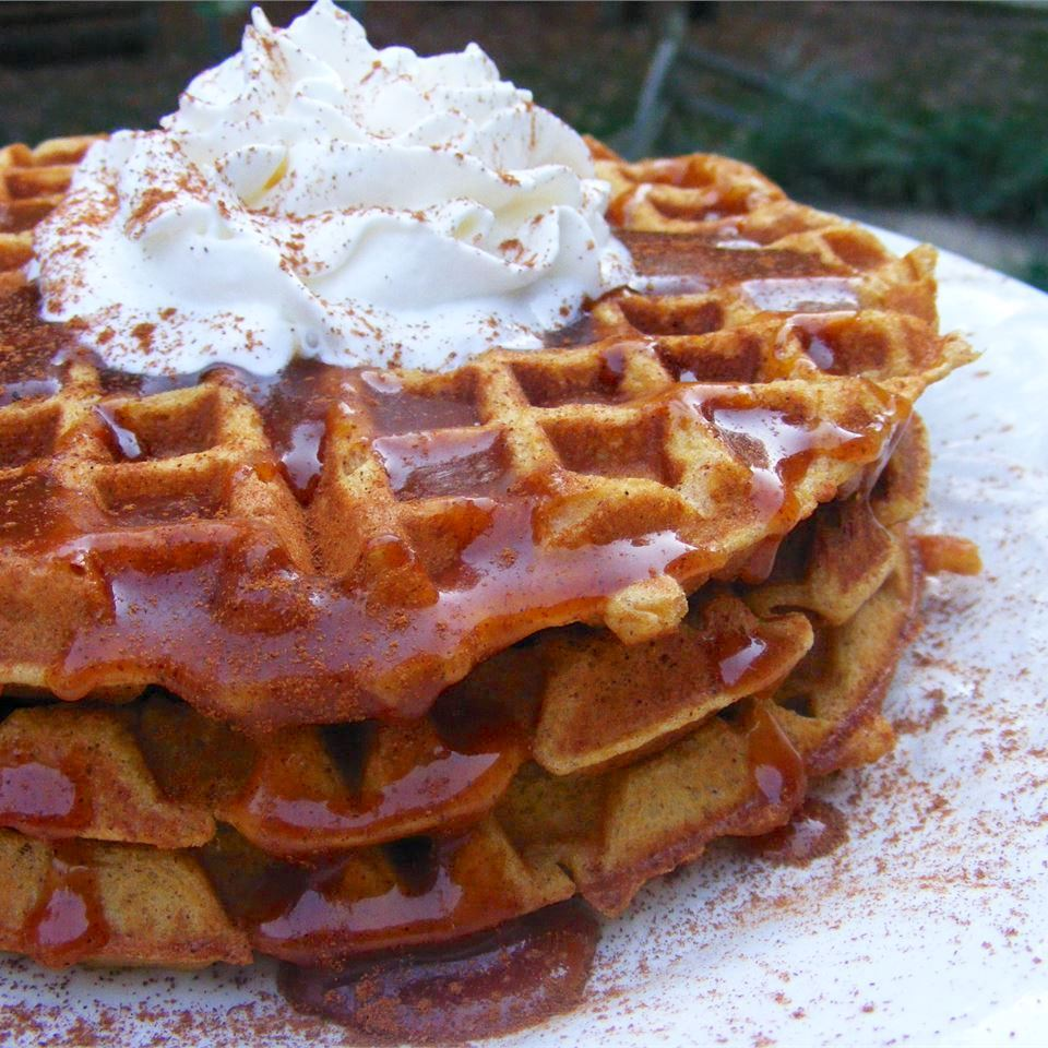 Pumpkin Waffles with Apple Cider Syrup topped with whipped cream