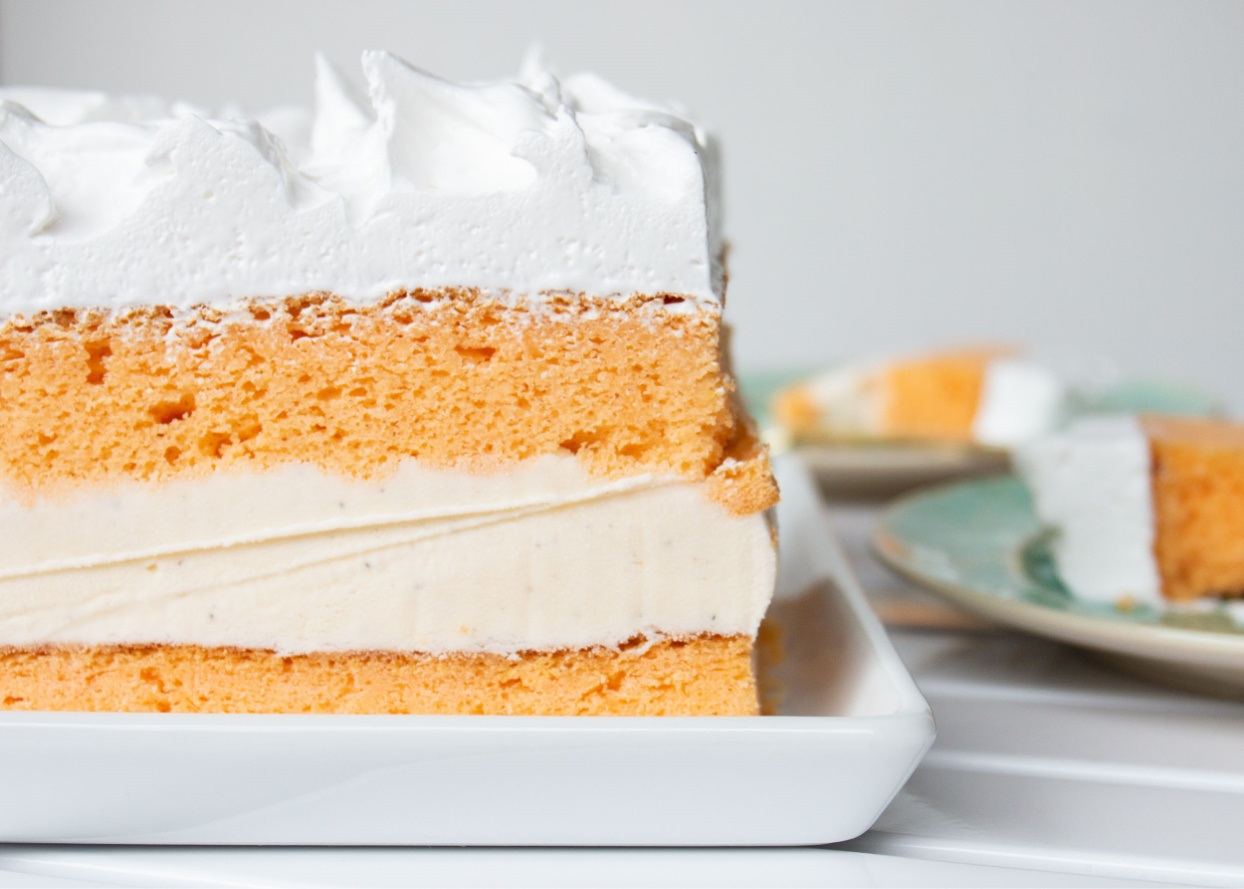 orange cake with vanilla ice cream filling and whipped topping