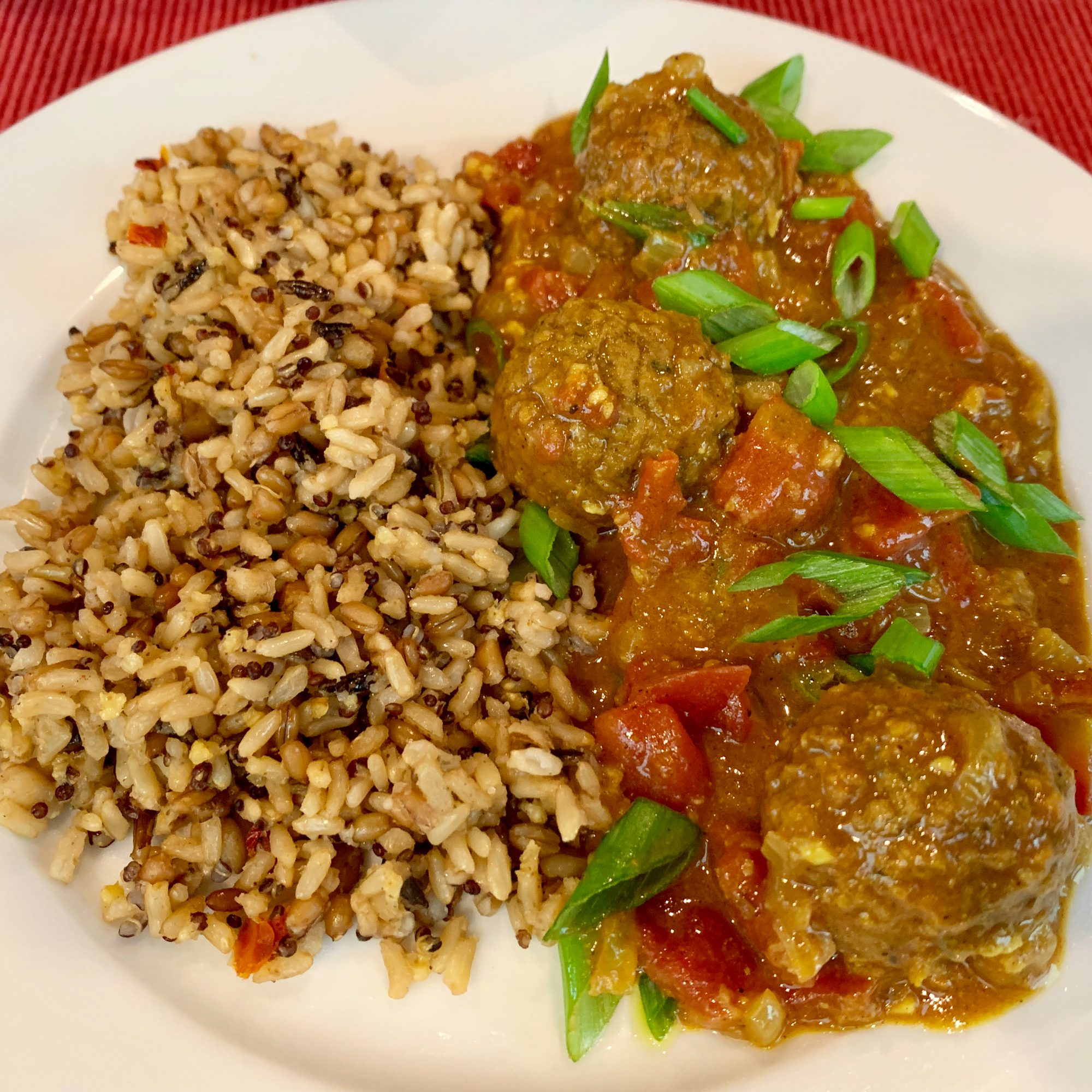 Easy Vegetarian Kofta Curry with rice on a white plate