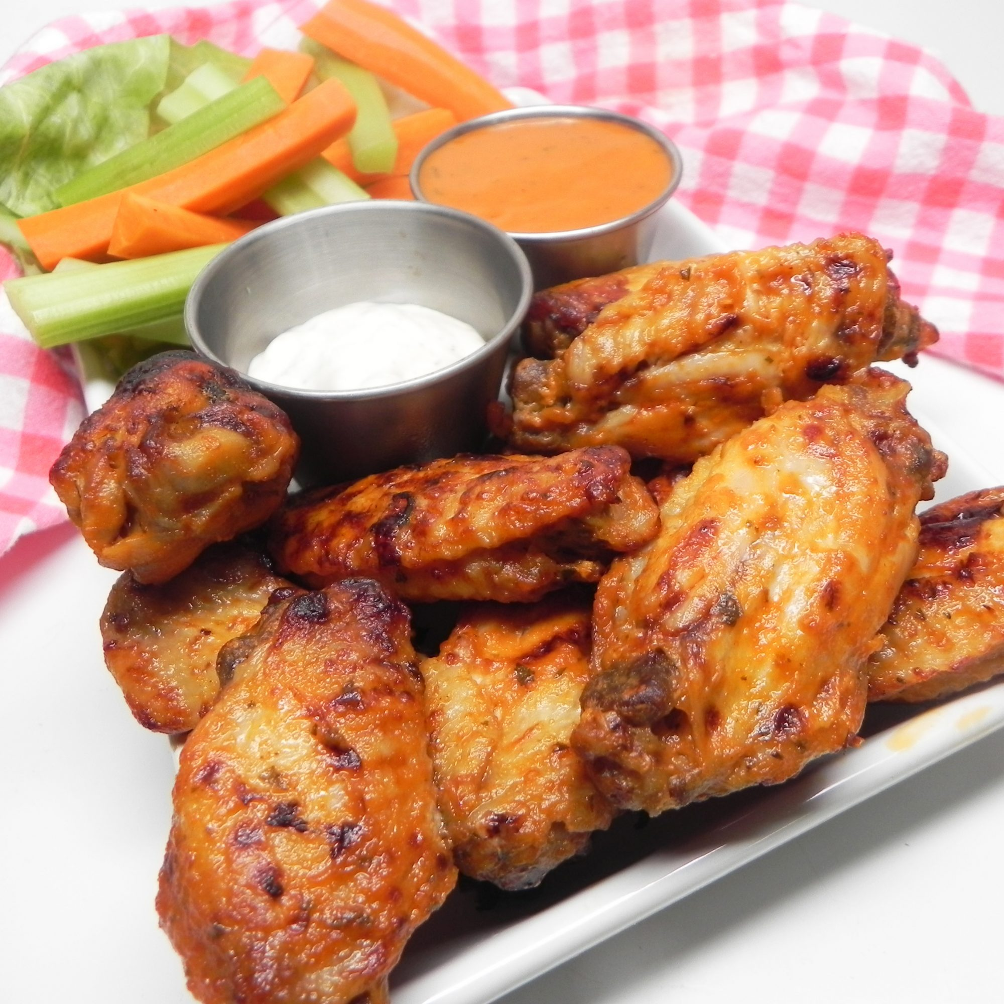 Instant Pot® Buffalo Wings on a white plate