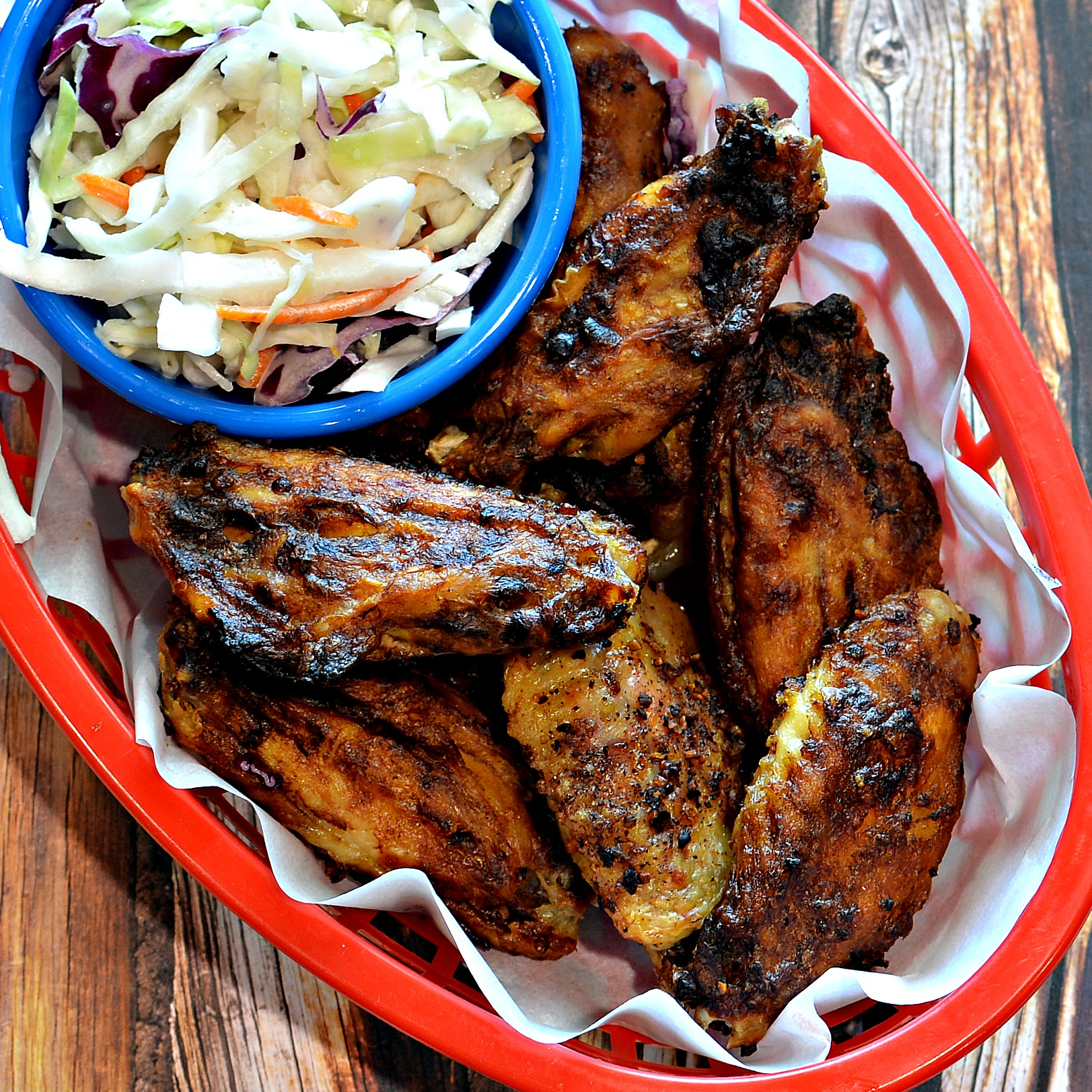 Instant Pot® Crispy Barbecue Chicken Wings with a side of coleslaw