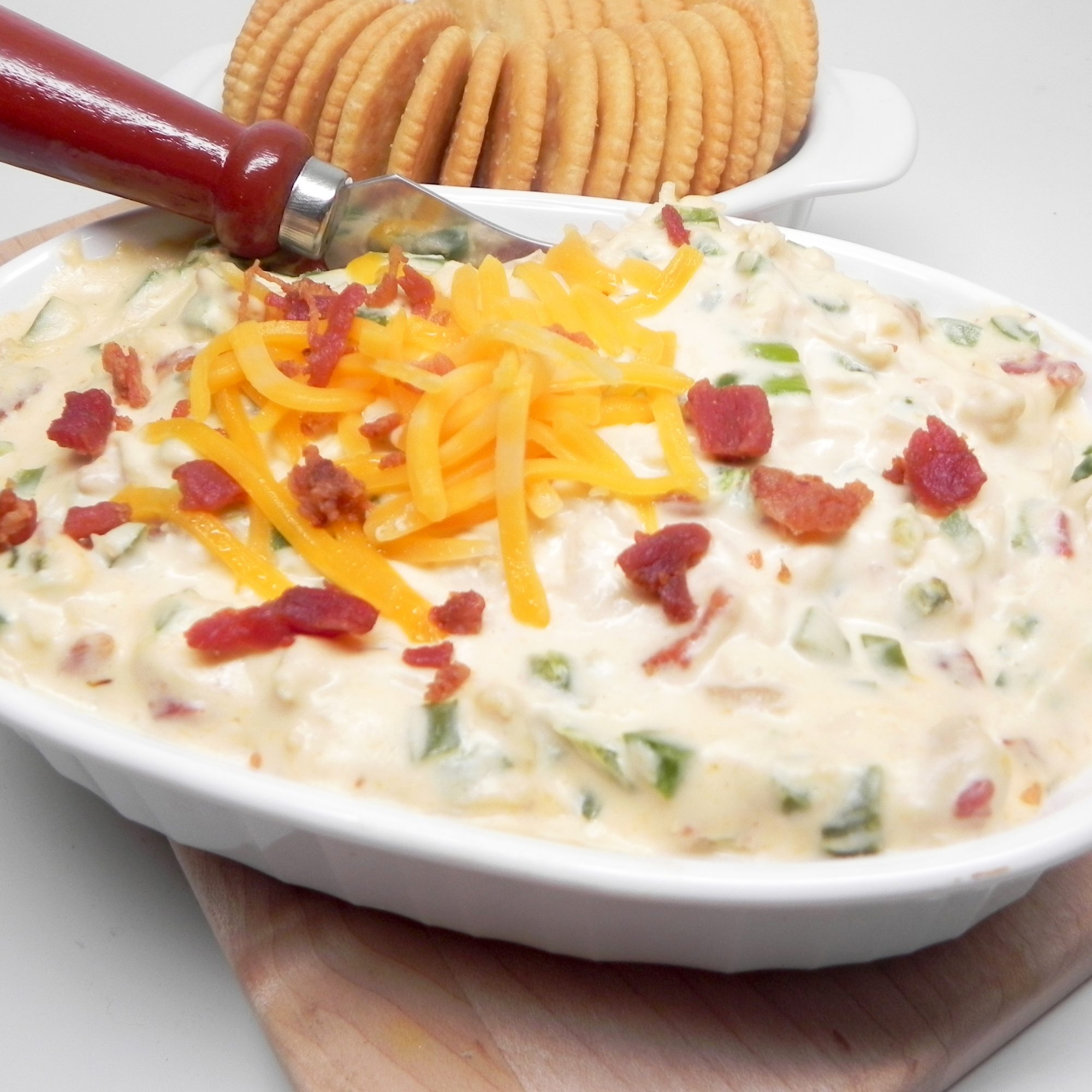 Instant Pot® Jalapeno-Chicken Popper Dip in a white bowl